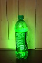 Glowing soda bottle